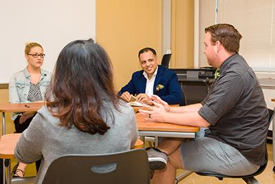 Mr. Jain met with graduate students during his visit to the university.