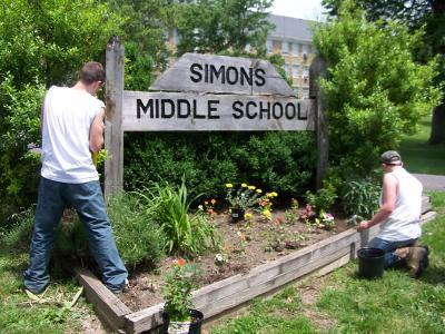 new bedding plants and shrubbery being landscaped at Simons Middle School