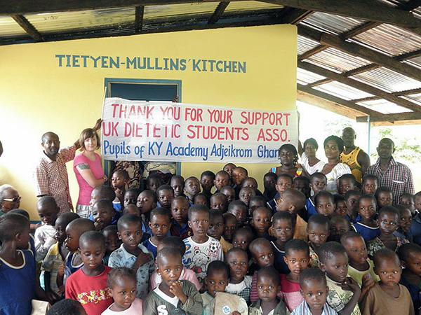 Students of the Kentucky Academy and people of the village of Adjeikrom express thanks to the Student Dietetic and Nutrition Association for support of the school feeding program.