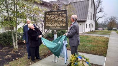 From left, Bob Weldon, Ann Vail and Jimmy Henning unveil the newest historical marker at UK.