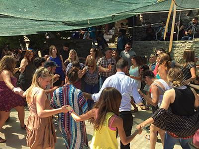 Students celebrating with locals on Ikaria