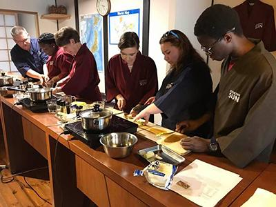 Bob Perry and students in cooking class