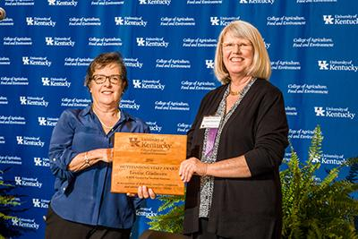 Nancy Cox presenting award to Louise Gladstone