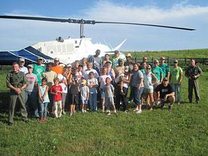 Operation Military Kids group in front of helicopter