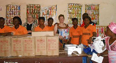 Kim Spillman and Marcia Rasner deliver sewing machines to the sewing cooperative in the village of Aseseeso