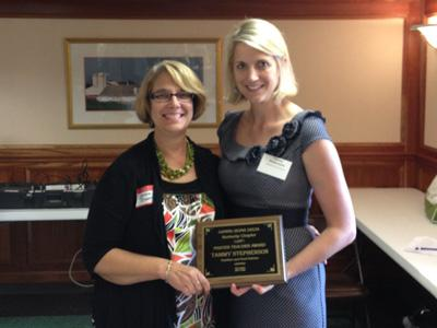 Dr. Stephenson receiving award from Dr. Bastin