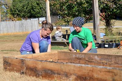 Volunteers construct raised beds at the community garden in Metcalfe County.