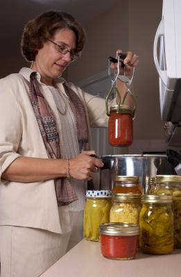Sandra Basting holding Food Preservation Boot Camp
