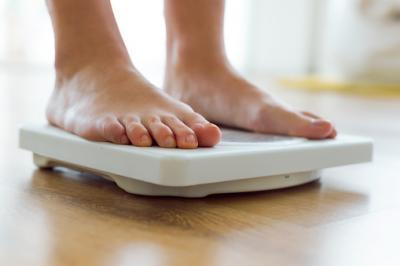 Photo: thinkstock.com - Feet on scale