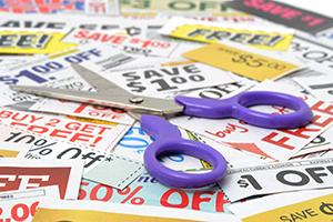 Scissors on pile of coupons