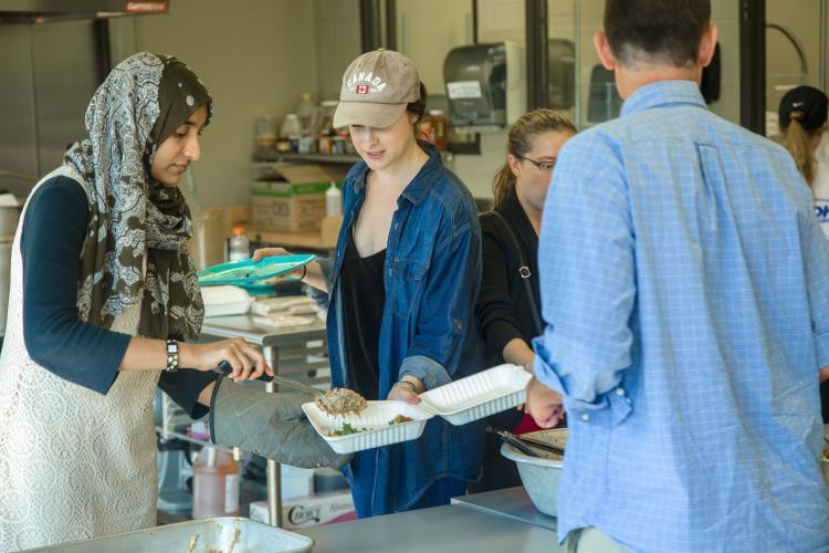 UK students serve meals to their peers as part of the Farm-to-Fork program.
