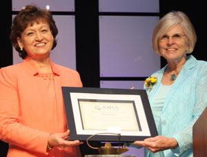 Martha Nall (left) receives AAFCS award from Bev Card. Photo courtesy of AAFCS