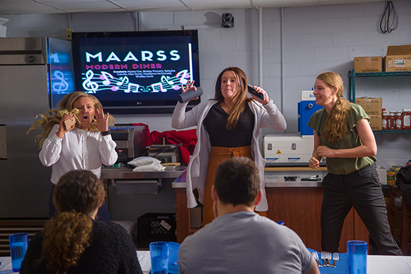 (From left to right) Alyssa Cox, Madilyne McDonald and Shelby Lowe, all DHN students from the MAARSS team, kick off their presentation with music and dancing, representing their modern diner concept.