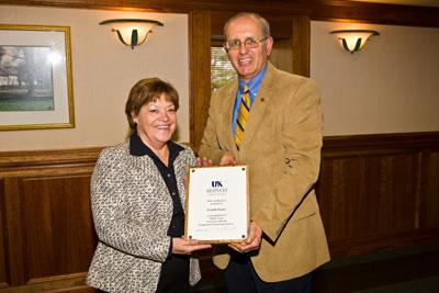 Liz Buckner receives recognition for thirty years of service in Cooperative Extension from Dr. Jimmy Henning, Associate Dean for Extension