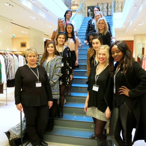 Dr. Scarlett Wesley (front left) and this year's study tour students during an appointment with a fashion retailer.