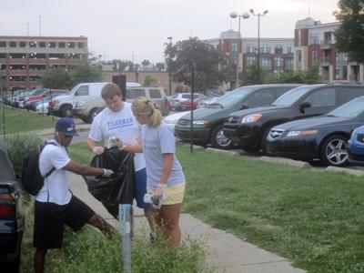 Students picking up trash and recyclables