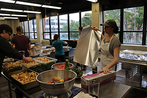 Students prepping food in Campus Kitchen workspace