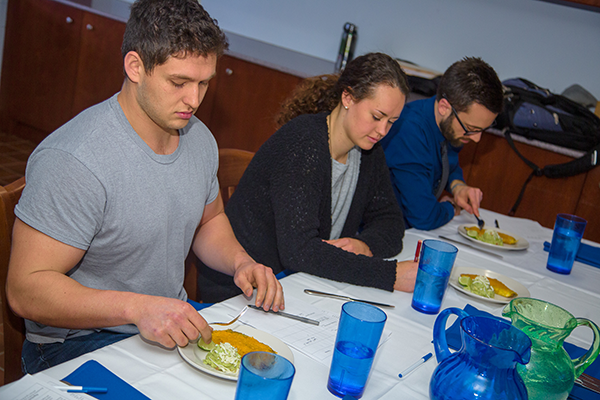 Jack Moreland, Katie Pierce and Aaron Schwartz, serve as judges and sample omelets as they decide which restaurant start-up to invest in for this mock contest.