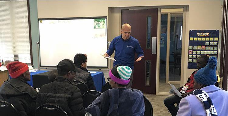 Jefferson County EFNEP assistant Omar Miralles Perez provides an educational program to participants with the Kentucky Refugee Ministries in Louisville. Photo provided by the Kentucky Nutrition Education Program.