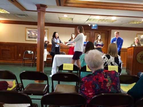 Caitlin Brown receiving certificate