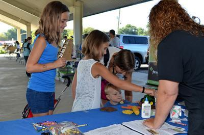 Audrey Stearman, Addelyn Stearman and Liam Hash complete an activity at the Hardin County POP Club.