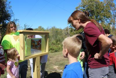 Children read book pages on the trail in the Owsley County Park - PHOTO: Owsley County Extension